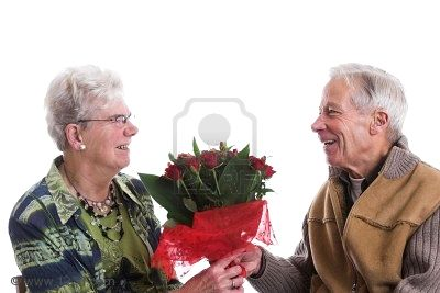 704322-happy-senior-couple-the-man-is-giving-his-wife-a-lovely-bouquet.jpg