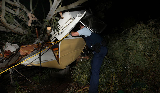 Firefighters cut a woman free from this wrecked caravan. She was taken to Wellington Hospital with moderate to serious injuries.